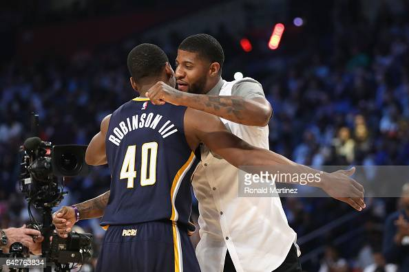 Glenn Robinson III of the Indiana Pacers reacts with Paul George of the Indiana Pacers during the 2017 Verizon Slam Dunk Contest at Smoothie King...