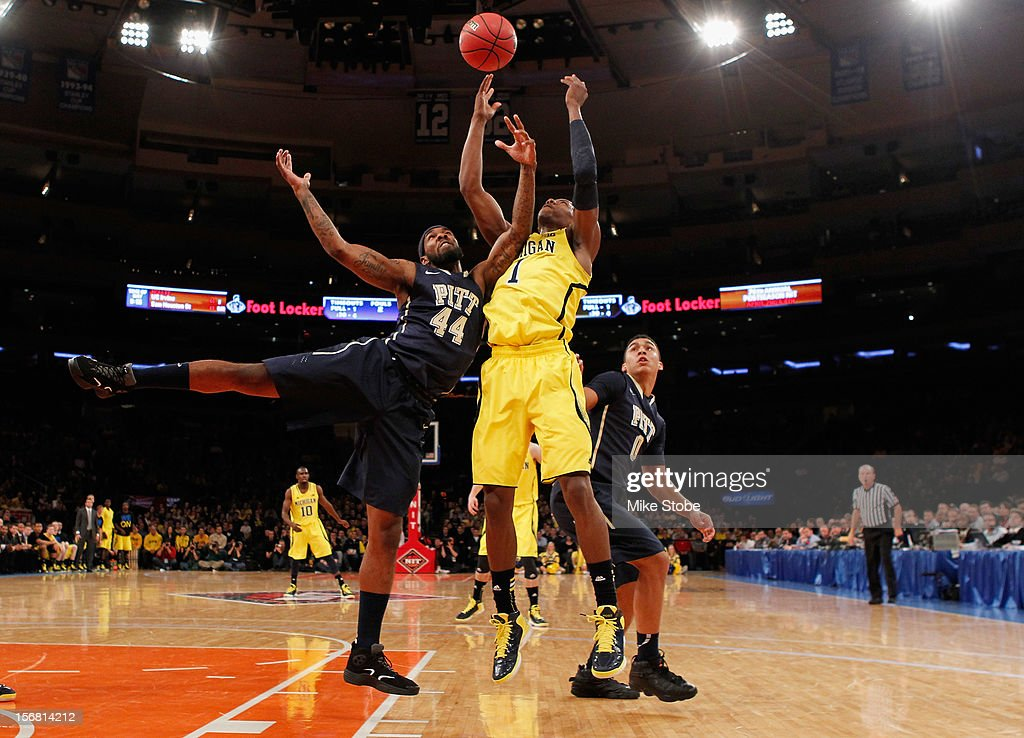 Glenn Robinson III #1 of the Michigan Wolverines and J.J. Moore #44 of the Pittsburgh Panthers go after the loose ball during the NIT Season Tip-Off at Madison Square Garden on November 21, 2012 in New York City. Michigan defeated Pittsburgh 67-62.