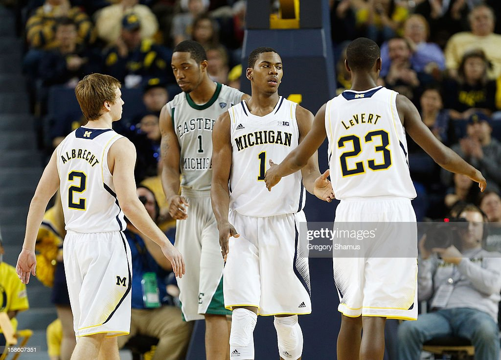 Glenn Robinson III #1 of the Michigan Wolverines celebrates a second half basket with Spike Albrecht #2 and Caris LeVert #23 in front of Da'Shonte Riley #1 of the Eastern Michigan Eaglesat Crisler Center on December 20, 2012 in Ann Arbor, Michigan.