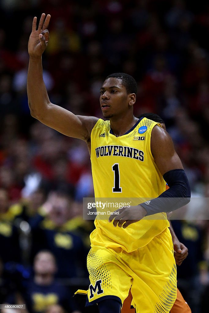 <a gi-track='captionPersonalityLinkClicked' href=/galleries/search?phrase=Glenn+Robinson+III&family=editorial&specificpeople=9920511 ng-click='$event.stopPropagation()'>Glenn Robinson III</a> #1 of the Michigan Wolverines celebrates a three point shot in the second half against the Texas Longhorns during the third round of the 2014 NCAA Men's Basketball Tournament at BMO Harris Bradley Center on March 22, 2014 in Milwaukee, Wisconsin.