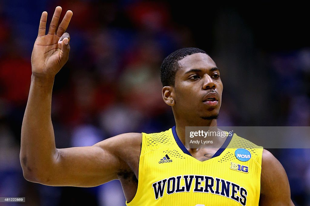 <a gi-track='captionPersonalityLinkClicked' href=/galleries/search?phrase=Glenn+Robinson+III&family=editorial&specificpeople=9920511 ng-click='$event.stopPropagation()'>Glenn Robinson III</a> #1 of the Michigan Wolverines celebrates a three pointer in the first half against the Tennessee Volunteers during the regional semifinal of the 2014 NCAA Men's Basketball Tournament at Lucas Oil Stadium on March 28, 2014 in Indianapolis, Indiana.