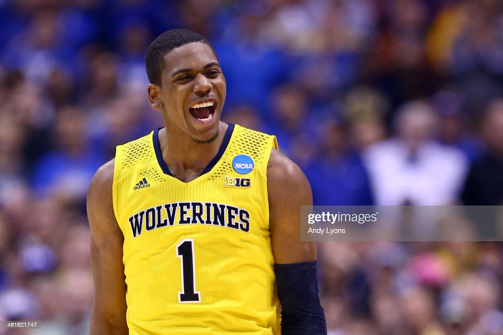 <a gi-track='captionPersonalityLinkClicked' href=/galleries/search?phrase=Glenn+Robinson+III&family=editorial&specificpeople=9920511 ng-click='$event.stopPropagation()'>Glenn Robinson III</a> #1 of the Michigan Wolverines celebrates after a basket in the second half against the Kentucky Wildcats during the midwest regional final of the 2014 NCAA Men's Basketball Tournament at Lucas Oil Stadium on March 30, 2014 in Indianapolis, Indiana.