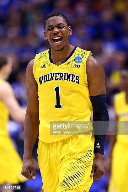 Glenn Robinson III of the Michigan Wolverines celebrates after a basket in the second half against the Kentucky Wildcats during the midwest regional...