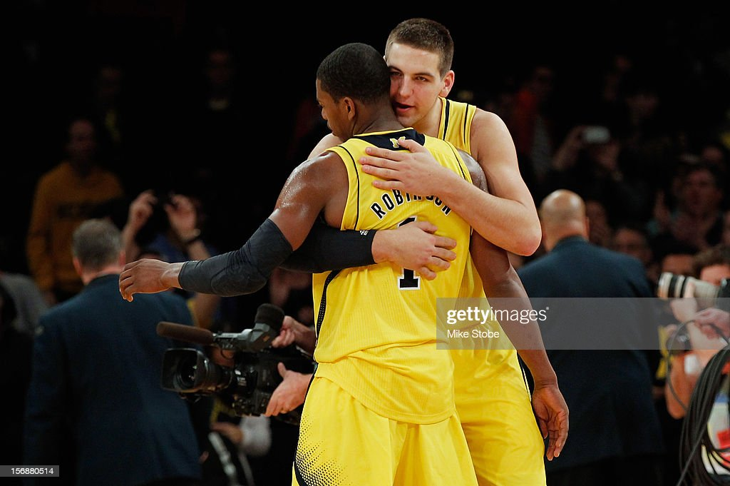 Glenn Robinson III #1 of the Michigan Wolverines celebrates with teammate Mitch McGary #4 after defeating the Kansas State Wildcats at Madison Square Garden on November 23, 2012 in New York City. Michigan Wolverines defeated Kansas State Wildcats 71-57.