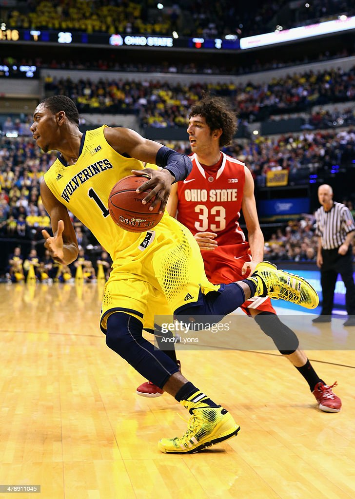 Glenn Robinson III #1 of the Michigan Wolverines drives the ball past Amedeo Della Valle #33 of the Ohio State Buckeyes during the first half of the Big Ten Basketball Tournament Semifinal game at Bankers Life Fieldhouse on March 15, 2014 in Indianapolis, Indiana.
