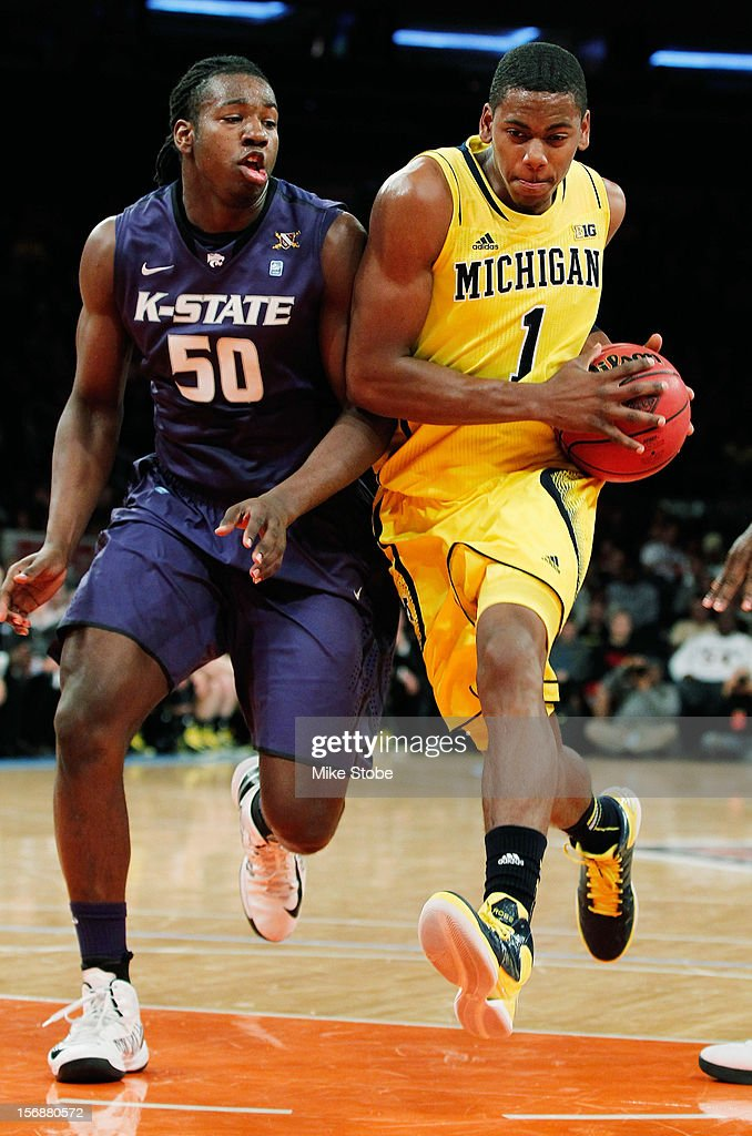 Glenn Robinson III #1 of the Michigan Wolverines drives towards the net against D.J. Johnson #50 of the Kansas State Wildcats at Madison Square Garden on November 23, 2012 in New York City. Michigan Wolverines defeated Kansas State Wildcats 71-57.