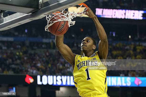 Glenn Robinson III of the Michigan Wolverines dunks in the first half against the Louisville Cardinals during the 2013 NCAA Men's Final Four...