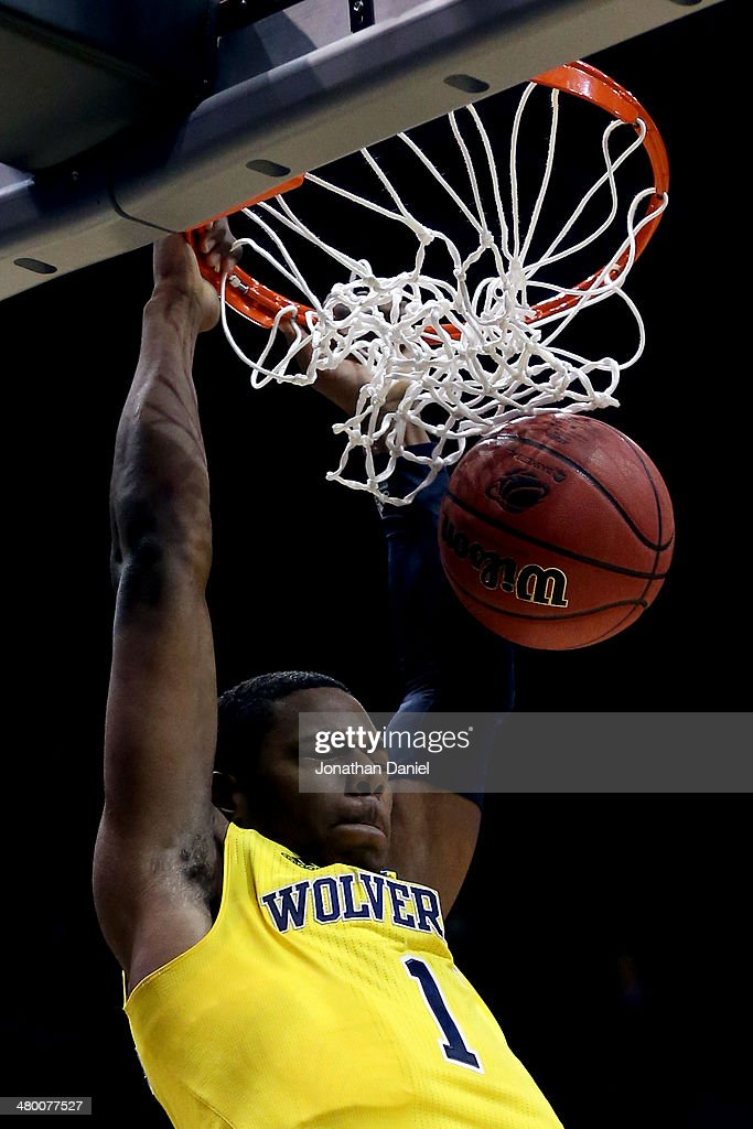 <a gi-track='captionPersonalityLinkClicked' href=/galleries/search?phrase=Glenn+Robinson+III&family=editorial&specificpeople=9920511 ng-click='$event.stopPropagation()'>Glenn Robinson III</a> #1 of the Michigan Wolverines dunks the ball in the first half against the Texas Longhorns during the third round of the 2014 NCAA Men's Basketball Tournament at BMO Harris Bradley Center on March 22, 2014 in Milwaukee, Wisconsin.
