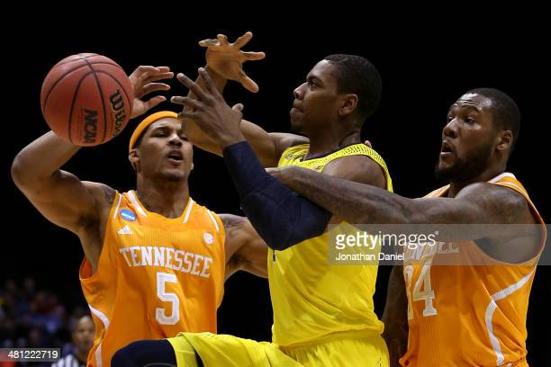 Glenn Robinson III of the Michigan Wolverines gets fouled by Jeronne Maymon of the Tennessee Volunteers in the first half during the regional...