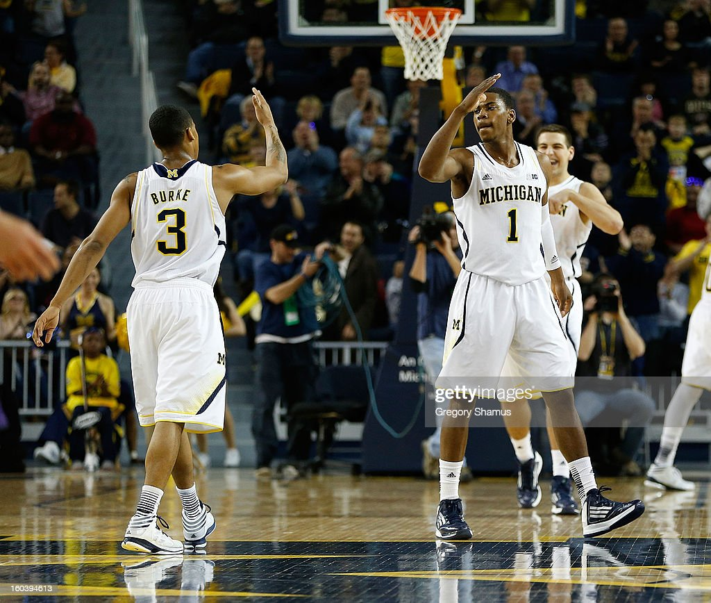 Glenn Robinson III #1 of the Michigan Wolverines high-fives Trey Burke #3 after a first half play against the Northwestern Wildcats at Crisler Center on January 30, 2013 in Ann Arbor, Michigan.