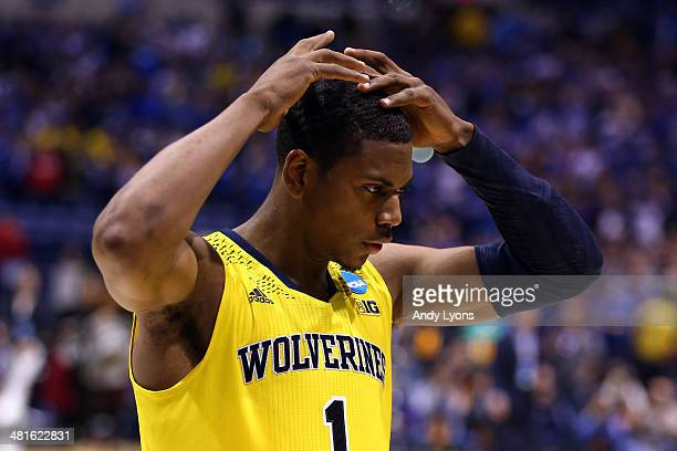 Glenn Robinson III of the Michigan Wolverines reacts after being defeated by the Kentucky Wildcats 75 to 72 in the midwest regional final of the 2014...