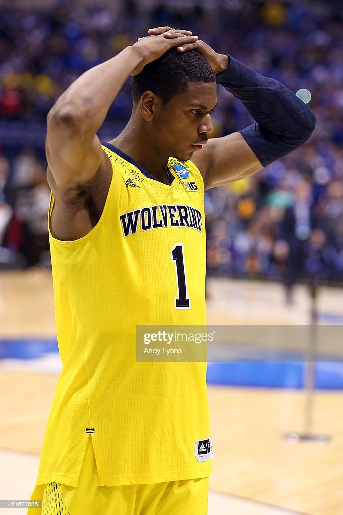 <a gi-track='captionPersonalityLinkClicked' href=/galleries/search?phrase=Glenn+Robinson+III&family=editorial&specificpeople=9920511 ng-click='$event.stopPropagation()'>Glenn Robinson III</a> #1 of the Michigan Wolverines reacts after being defeated by the Kentucky Wildcats 75 to 72 in the midwest regional final of the 2014 NCAA Men's Basketball Tournament at Lucas Oil Stadium on March 30, 2014 in Indianapolis, Indiana.