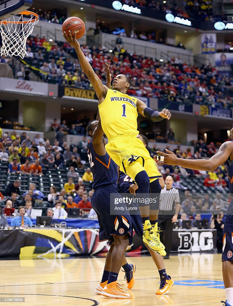 <a gi-track='captionPersonalityLinkClicked' href=/galleries/search?phrase=Glenn+Robinson+III&family=editorial&specificpeople=9920511 ng-click='$event.stopPropagation()'>Glenn Robinson III</a> #1 of the Michigan Wolverines shoots the ball in the game against the Illinois Fighting Illini during the Quarterfinals of the Big Ten Basketball Tournament at Bankers Life Fieldhouse on March 14, 2014 in Indianapolis, Indiana.