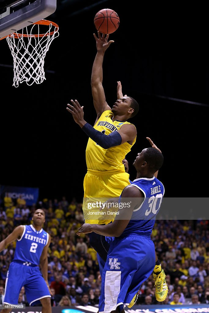 <a gi-track='captionPersonalityLinkClicked' href=/galleries/search?phrase=Glenn+Robinson+III&family=editorial&specificpeople=9920511 ng-click='$event.stopPropagation()'>Glenn Robinson III</a> #1 of the Michigan Wolverines shoots the ball over <a gi-track='captionPersonalityLinkClicked' href=/galleries/search?phrase=Julius+Randle&family=editorial&specificpeople=10784969 ng-click='$event.stopPropagation()'>Julius Randle</a> #30 of the Kentucky Wildcats in the first half of the midwest regional final of the 2014 NCAA Men's Basketball Tournament at Lucas Oil Stadium on March 30, 2014 in Indianapolis, Indiana.