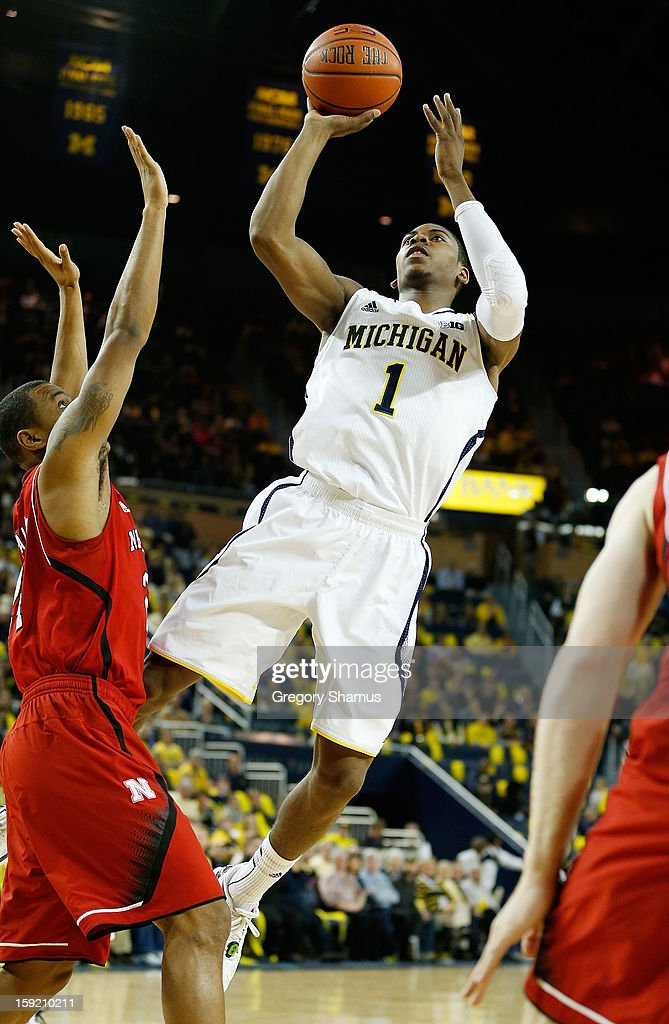 Glenn Robinson III #1 of the Michigan Wolverines takes a first half shot over Dylan Talley #24 of the Nebraska Cornhuskers at Crisler Center on January 9, 2013 in Ann Arbor, Michigan.