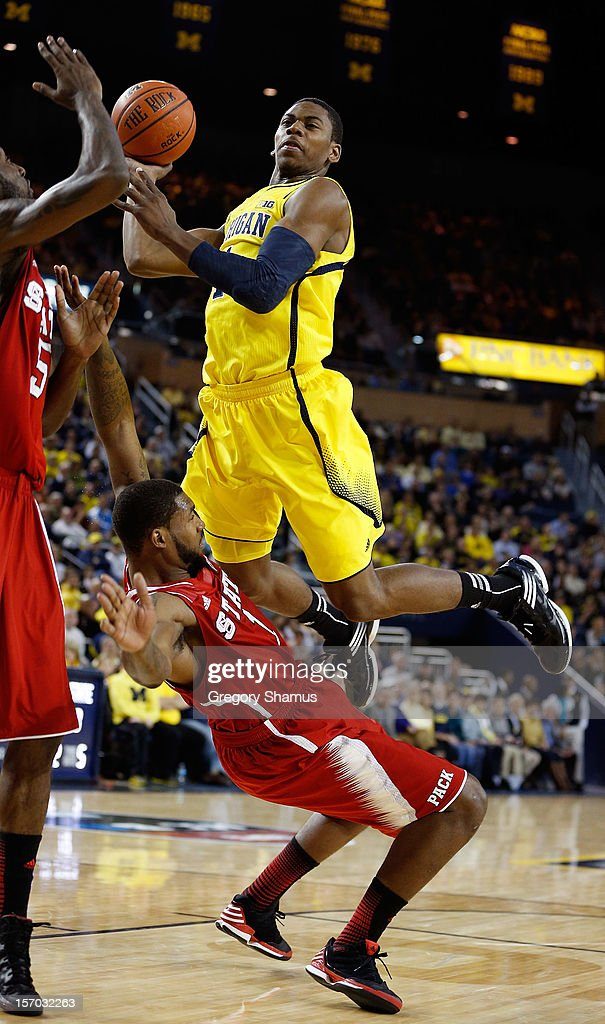 Glenn Robinson III #1 of the Michigan Wolverines tries to get a first half shot off over <a gi-track='captionPersonalityLinkClicked' href=/galleries/search?phrase=Richard+Howell&family=editorial&specificpeople=2313901 ng-click='$event.stopPropagation()'>Richard Howell</a> #1 of the North Carolina State Wolfpack at Crisler Center on November 27, 2012 in Ann Arbor, Michigan.