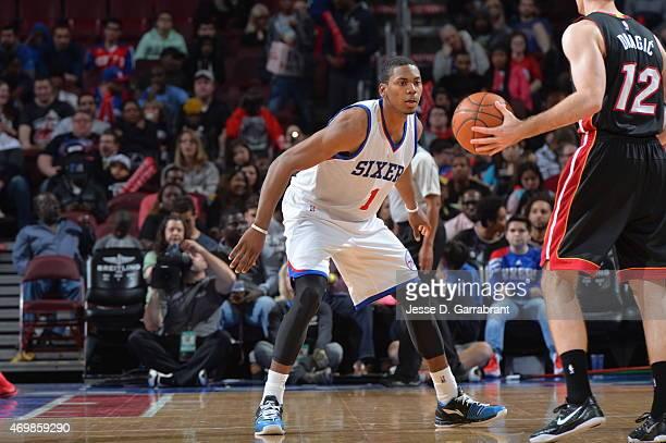Glenn Robinson III of the Philadelphia 76ers plays defense against the Miami Heat at Wells Fargo Center on April 15 2015 in Philadelphia Pennsylvania...