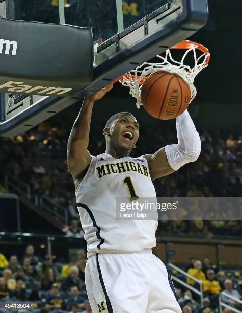 Glenn Robinson III of the University of Michigan Wolverines dunks the ball during the first half of the game against Houston Baptist Huskies at...
