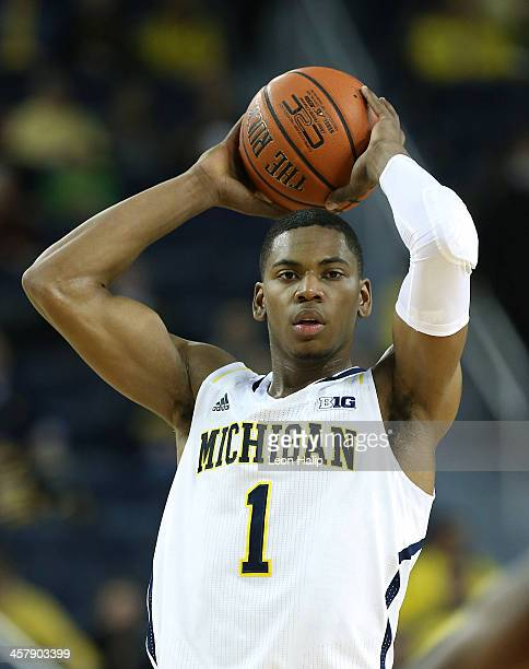 Glenn Robinson III of the University of Michigan Wolverines looks to pass the ball during the second half of the game against Houston Baptist Huskies...