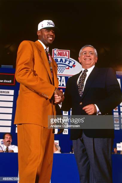 Glenn Robinson selected number one overall by the Milwaukee Bucks shakes hands with NBA Commissioner David Stern during the 1994 NBA Draft on June 29...