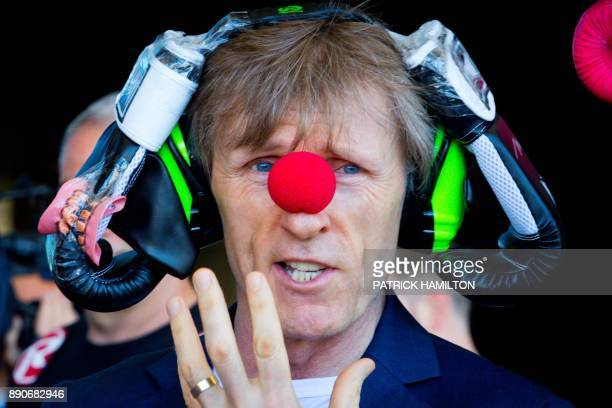 Glenn Rushton coach of Australian boxer Jeff Horn wears a clown's nose and other silly paraphernalia over his head as part of prefight banter during...
