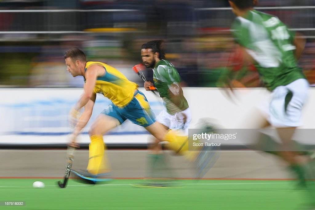 Glenn Simpson of Australia runs with the ball during the match between the Australia and Pakistan during day three of the Champions Trophy at the State Netball Hockey Centre on December 4, 2012 in Melbourne, Australia.