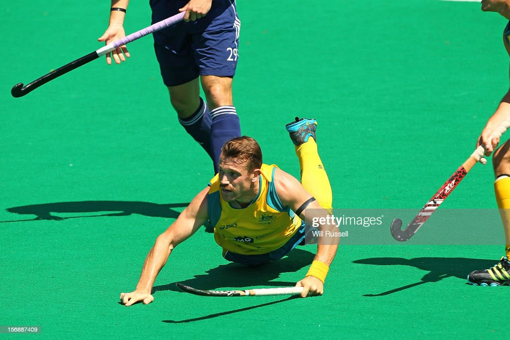 Glenn Simpson slides on the ground after taking a shot on goal during the Australia v England game during day two of the 2012 International Super Series at Perth Hockey Stadium on November 23, 2012 in Perth, Australia.