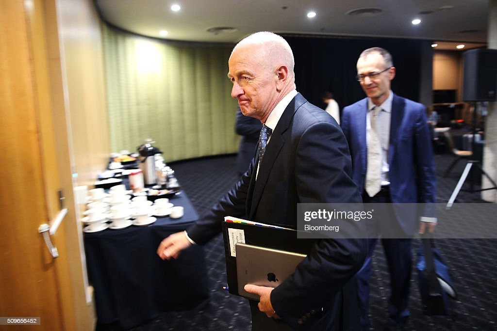 Glenn Stevens, governor of the Reserve Bank of Australia, center, and Philip Lowe, deputy governor, leave a hearing before the House of Representatives economics committee in Sydney, Australia, on Friday, Feb. 12, 2016. Australia has the flexibility to ease monetary policy further if that will aid the economy, Stevens said Friday as he gauges the sustainability of recent jobs strength against the potential impact of global market upheaval on demand. Photographer: Brendon Thorne/Bloomberg via Getty Images