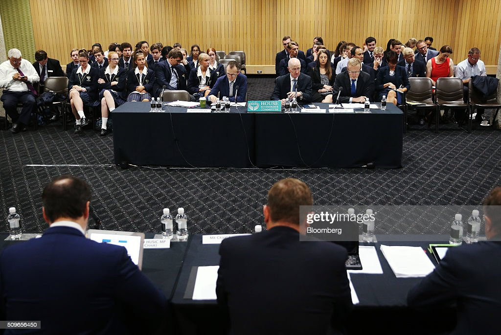 Glenn Stevens, governor of the Reserve Bank of Australia, center right, speaks during a hearing before the House of Representatives economics committee in Sydney, Australia, on Friday, Feb. 12, 2016. Australia has the flexibility to ease monetary policy further if that will aid the economy, Stevens said Friday as he gauges the sustainability of recent jobs strength against the potential impact of global market upheaval on demand. Photographer: Brendon Thorne/Bloomberg via Getty Images
