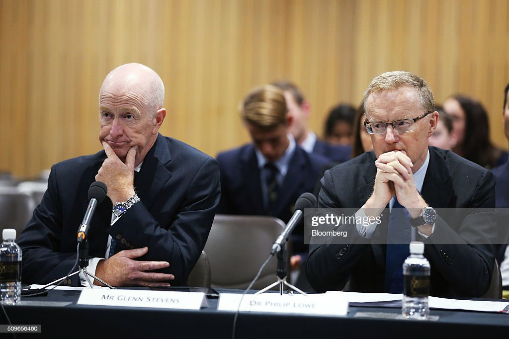 Glenn Stevens, governor of the Reserve Bank of Australia, left, and Philip Lowe, deputy governor, attend a hearing before the House of Representatives economics committee in Sydney, Australia, on Friday, Feb. 12, 2016. Australia has the flexibility to ease monetary policy further if that will aid the economy, Stevens said Friday as he gauges the sustainability of recent jobs strength against the potential impact of global market upheaval on demand. Photographer: Brendon Thorne/Bloomberg via Getty Images