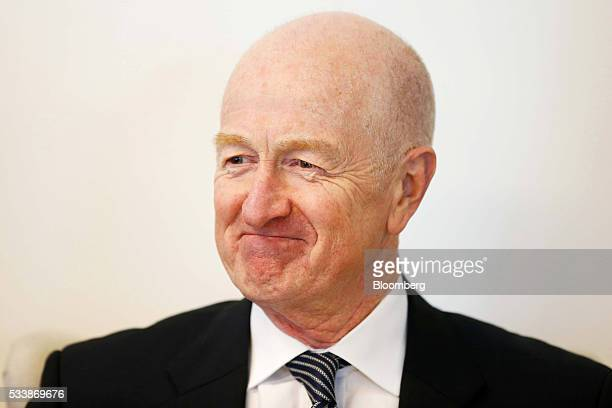 Glenn Stevens governor of the Reserve Bank of Australia reacts as he greets guests before speaking at an event hosted by the TransTasman Business...