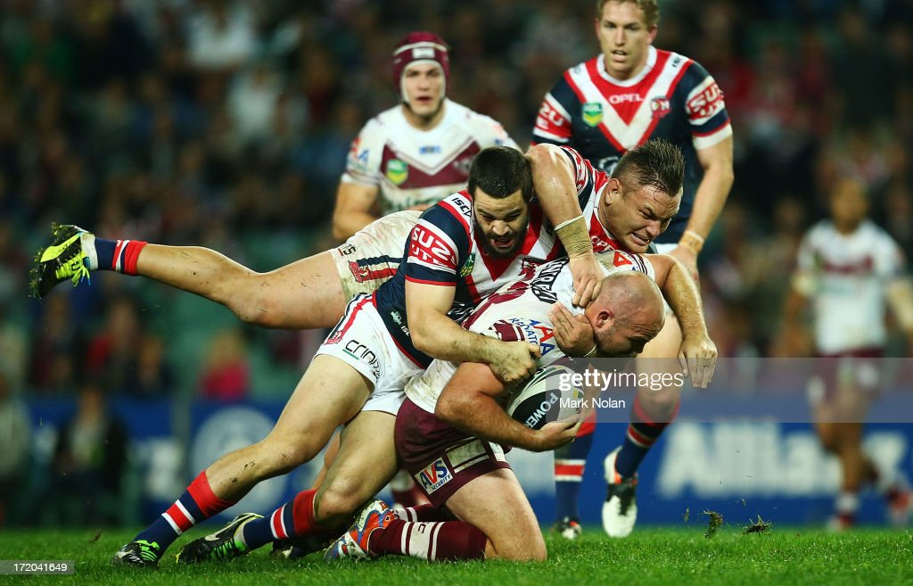 Glenn Stewart of the Eagles is tackled by Aidan Guerra and <a gi-track='captionPersonalityLinkClicked' href=/galleries/search?phrase=Jared+Waerea-Hargreaves&family=editorial&specificpeople=4252892 ng-click='$event.stopPropagation()'>Jared Waerea-Hargreaves</a> of the Roosters during the round 16 NRL match between the Sydney Roosters and the Manly Sea Eagles at Allianz Stadium on July 1, 2013 in Sydney, Australia.