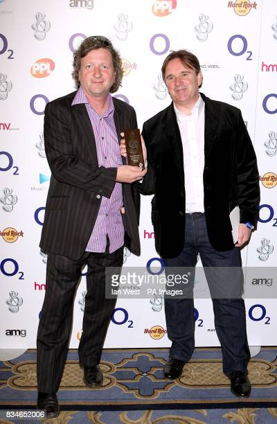 Glenn Tillbrook and Chris Difford of Squeeze with their Icon Award at the O2 Silver Clef Awards held in the Hilton Hotel central London