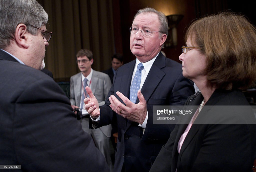 Glenn Tilton, chairman, president and chief executive officer of United Airlines, center, speaks to Bill McGee, consultant with Consumers Union, left, and Ellen Bloom, director of federal policy with Consumers Union, following an Antitrust, Competition Policy and Consumer Rights Subcommittee hearing on the proposed merger between United Airlines and Continental Airlines Inc. in Washington, D.C., U.S., on Thursday, May 27, 2010. United Airlines' proposed merger with Continental Airlines won't cut competition because discount carriers can begin service and win passengers, the chief executives of the two companies told a Senate antitrust panel. Photographer: Andrew Harrer/Bloomberg via Getty Images