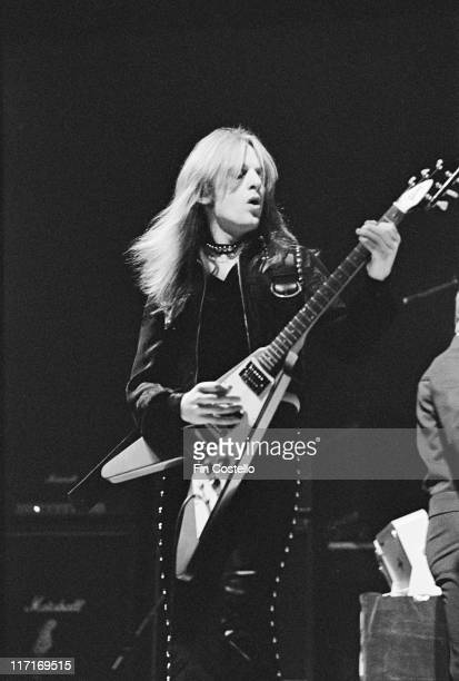 Glenn Tipton guitarist with British rock band Judas Priest playing the guitar on stage during a live concert performance at the Coventry Theatre in...