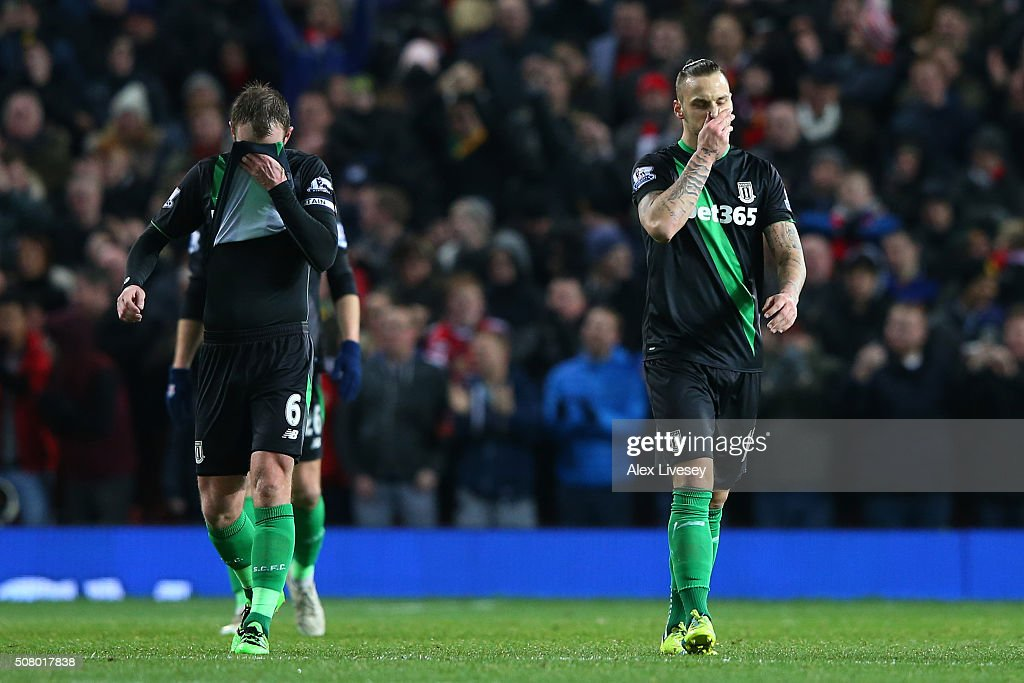 <a gi-track='captionPersonalityLinkClicked' href=/galleries/search?phrase=Glenn+Whelan&family=editorial&specificpeople=878267 ng-click='$event.stopPropagation()'>Glenn Whelan</a> (L) and <a gi-track='captionPersonalityLinkClicked' href=/galleries/search?phrase=Marko+Arnautovic&family=editorial&specificpeople=5567995 ng-click='$event.stopPropagation()'>Marko Arnautovic</a> (R) of Stoke City reacts after Manchester United's first goal during the Barclays Premier League match between Manchester United and Stoke City at Old Trafford on February 2, 2016 in Manchester, England.