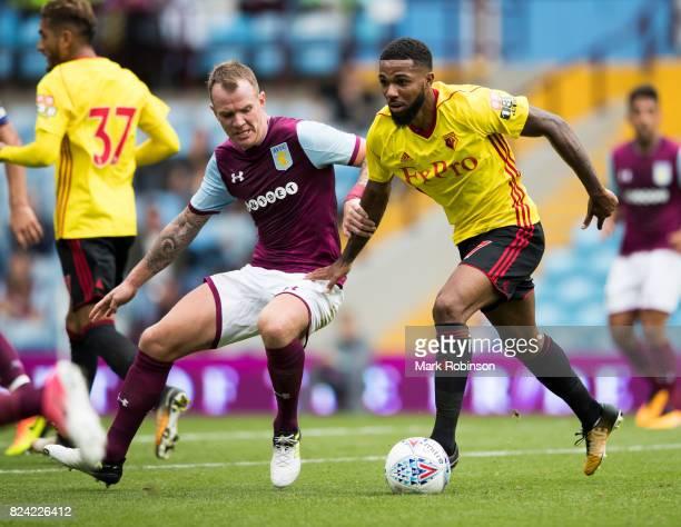 Glenn Whelan of Aston Villa and Jerome Sinclair of Watford during the pre season friendly match between Aston Villa and Watford at Villa Park on July...