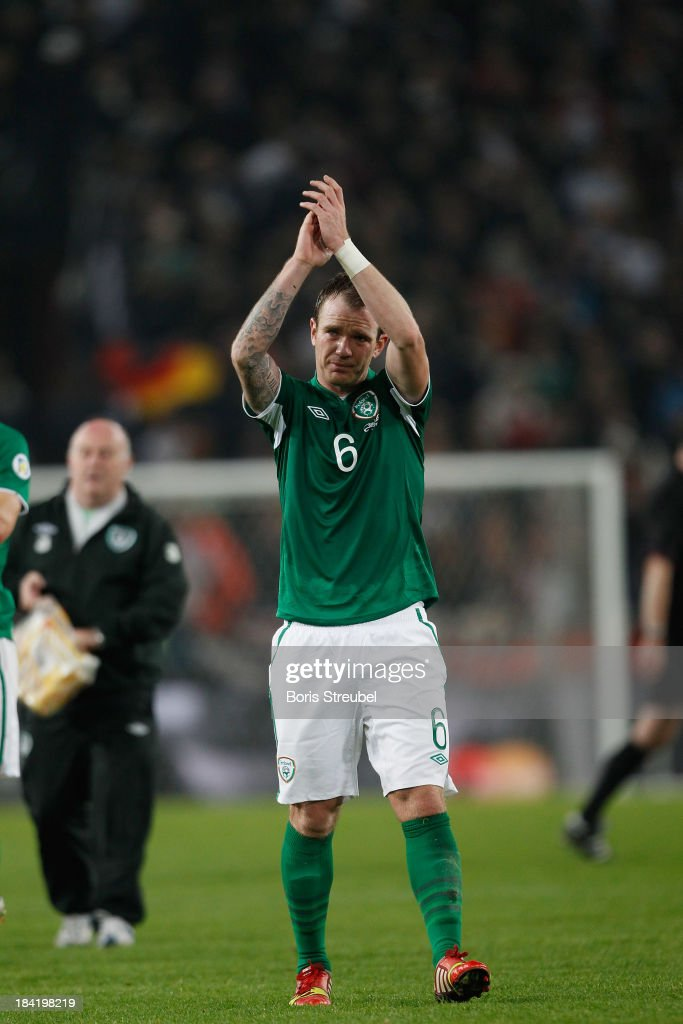 <a gi-track='captionPersonalityLinkClicked' href=/galleries/search?phrase=Glenn+Whelan&family=editorial&specificpeople=878267 ng-click='$event.stopPropagation()'>Glenn Whelan</a> of Ireland reacts after the FIFA 2014 World Cup qualifier group C match between Germany and Republic of Ireland at RheinEnergieStadion on October 11, 2013 in Cologne, Germany.