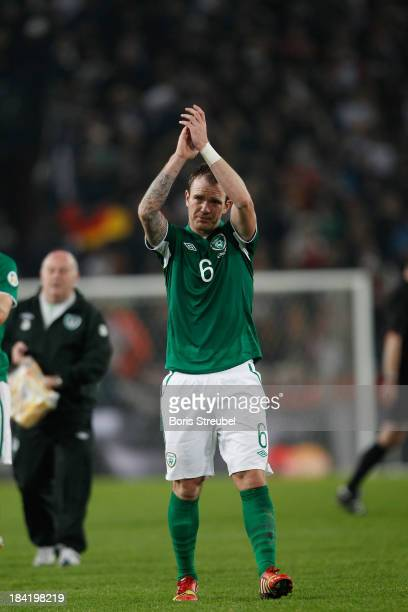 Glenn Whelan of Ireland reacts after the FIFA 2014 World Cup qualifier group C match between Germany and Republic of Ireland at RheinEnergieStadion...