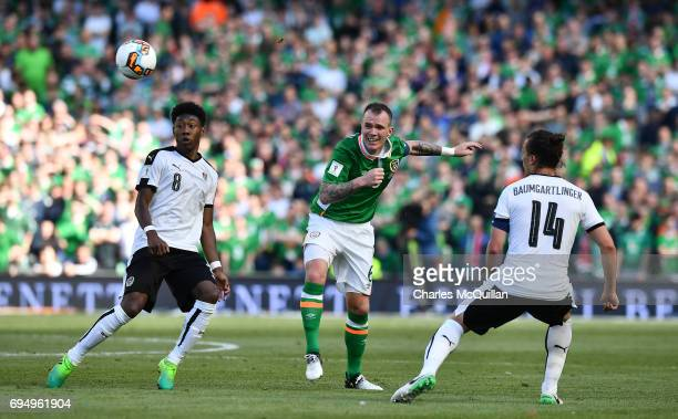 Glenn Whelan of Republic of Ireland and David Alaba of Austria during the FIFA 2018 World Cup Qualifier between Republic of Ireland and Austria at...