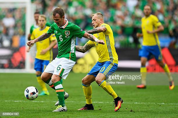 Glenn Whelan of Republic of Ireland and John Guidetti of Sweden compete for the ball during the UEFA EURO 2016 Group E match between Republic of...