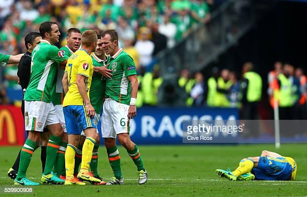 Glenn Whelan of Republic of Ireland and Sebastian Larsson of Sweden face off as Whelan fouling Oscar Lewicki of Sweden during the UEFA EURO 2016...