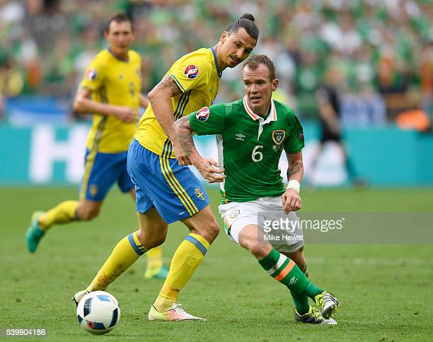Glenn Whelan of Republic of Ireland and Zlatan Ibrahimovic of Sweden compete for the ball during the UEFA EURO 2016 Group E match between Republic of...