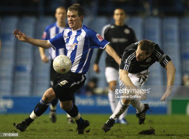 Glenn Whelan of Sheffield Wednesday holds off the challenge of Andy Todd of Derby County during the EON sponsored FA Cup Third Round Replay match...