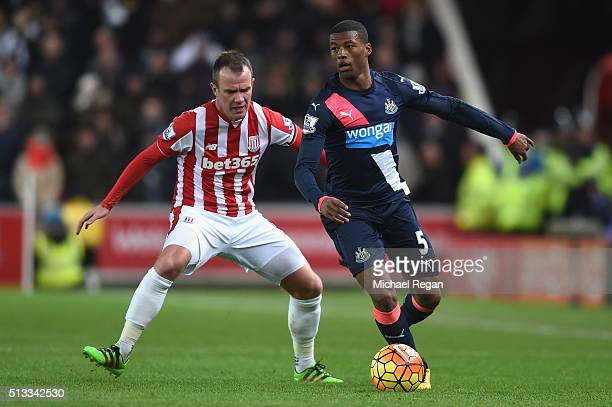 Glenn Whelan of Stoke City and Georginio Wijnaldum of Newcastle United in action during the Barclays Premier League match between Stoke City and...