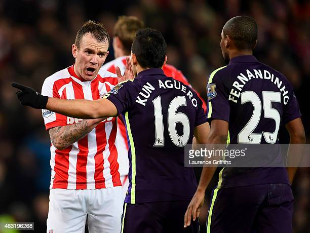 Glenn Whelan of Stoke City argues with Sergio Aguero of Manchester City after he had a goal disallowed for handball during the Barclays Premier...