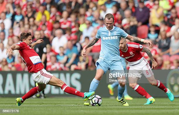 Glenn Whelan of Stoke City battle for possession with Gaston Ramirez of Middlesbrough during the Premier League match between Middlesbrough and Stoke...