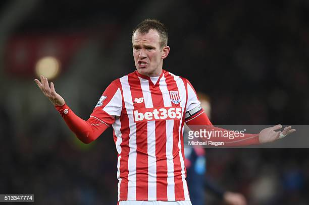 Glenn Whelan of Stoke City gestures during the Barclays Premier League match between Stoke City and Newcastle United at the Britannia Stadium on...