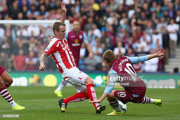 Glenn Whelan of Stoke City in action with Andreas Weimann of Aston Villa during the Barclays Premier League match between Stoke City and Aston Villa...
