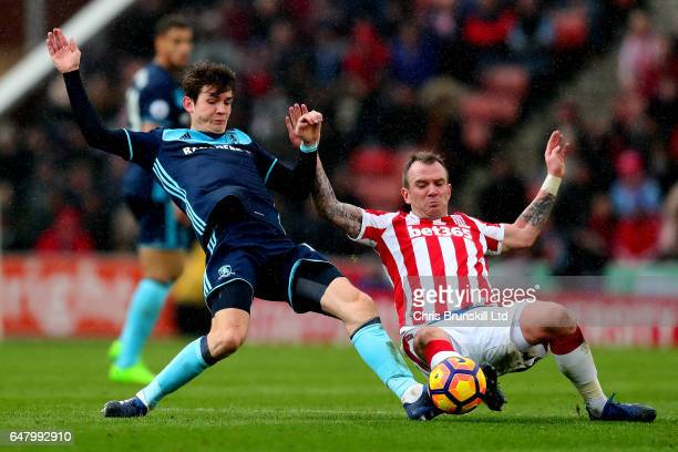 Glenn Whelan of Stoke City in action with Marten De Roon of Middlesbrough during the Premier League match between Stoke City and Middlesbrough at...